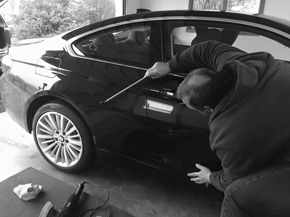 Removing dents on a car with PDR process